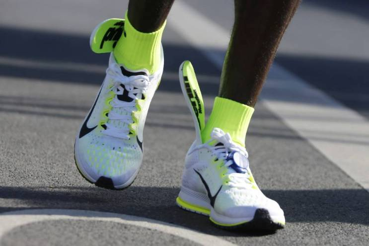 Eliud Kipchoge's shoes during the Berlin Marathon. PHOTO: HANNIBAL HANSCHKE/REUTERS