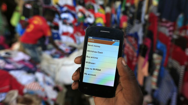 A man uses his M-Pesa account in Nairobi PHOTO: NOOR KHAMIS/REUTERS